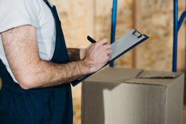 Delivery man filling cargo declaration stock vector