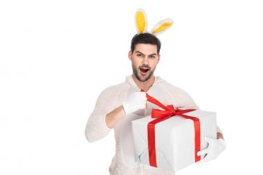 Man in rabbit costume taking off ribbon from gift box isolated on white, easter concept