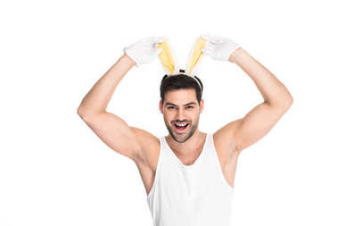 Smiling man with bunny ears isolated on white, easter concept