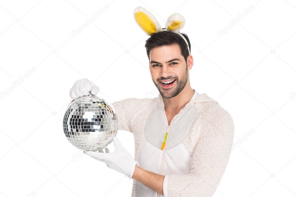 Smiling man in rabbit costume holding disco ball isolated on white, easter concept