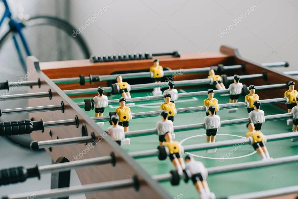table soccer and bicycle in living room