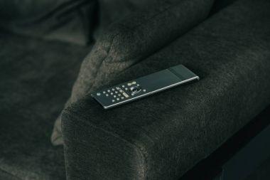 remote control on dark grey sofa