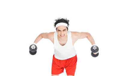 Portrait of young thin man in sportswear exercising with dumbbells isolated on white