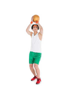 Skinny sportsman in headband preparing to throw ball isolated on white