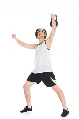Thin sportsman holding kettlebell in hand isolated on white