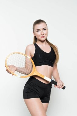 Blonde woman in sport clothes holding tennis racket isolated on white