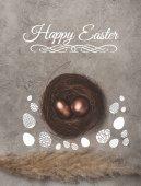 pohled shora zlaté velikonoční vajíčka v hnízdě na betonový podklad s nápisem Veselé Velikonoce