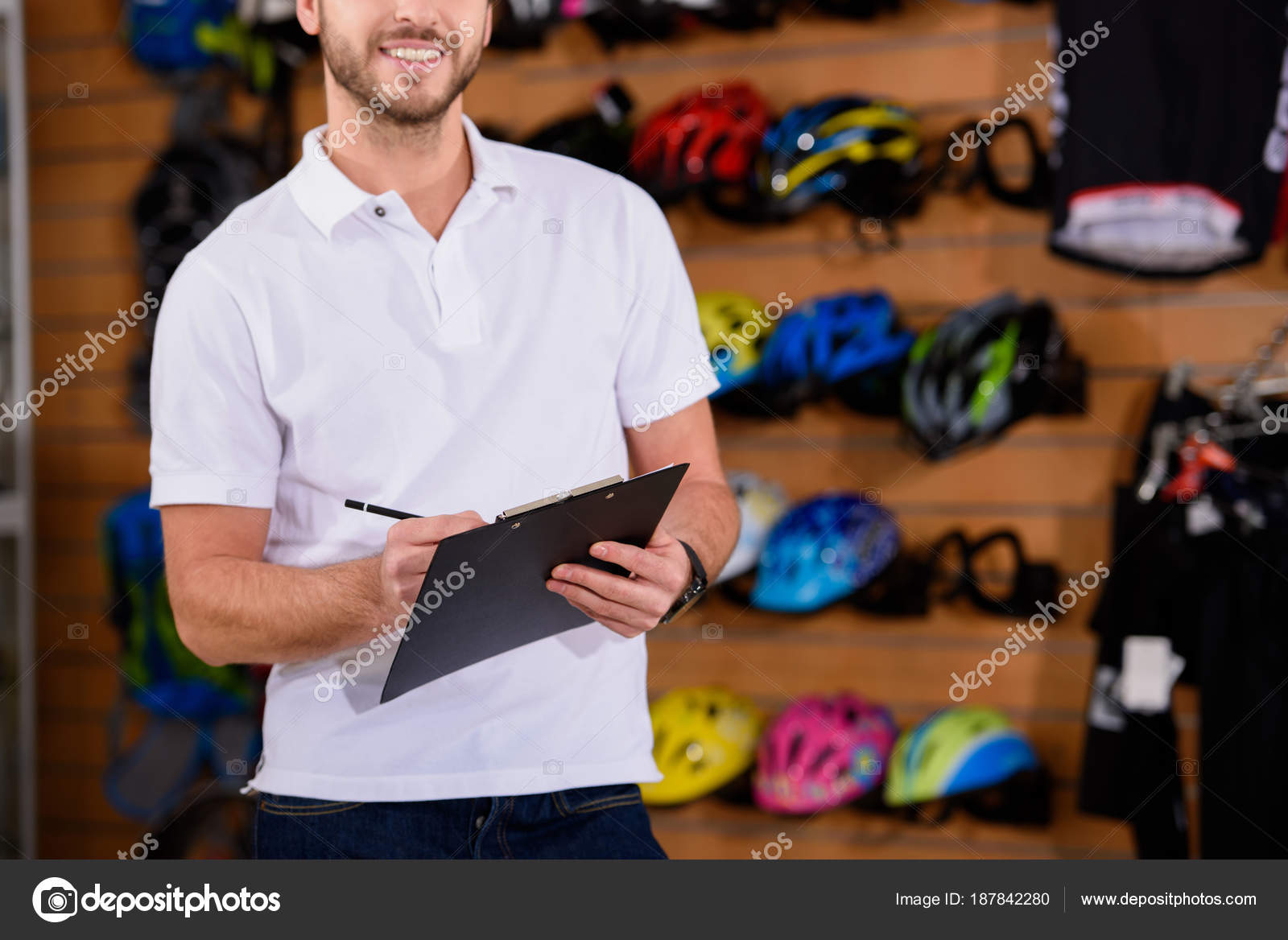 Cropped Shot Smiling Young Manager Writing Clipboard Bike