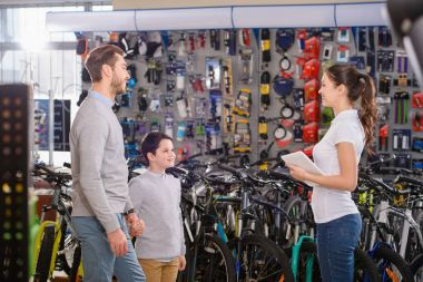 father and son buying bicycles