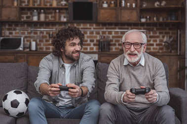 Happy adult son and senior father playing video game together at home stock vector