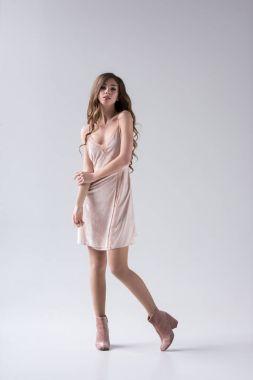Tender girl posing in lovely dress, isolated on grey stock vector