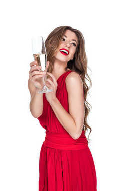 attractive smiling girl in red dress holding champagne glass, isolated on white