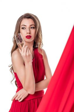 attractive girl posing in red dress with champagne glass, isolated on white