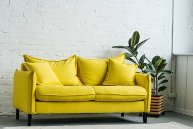 Modern light room interior with yellow sofa