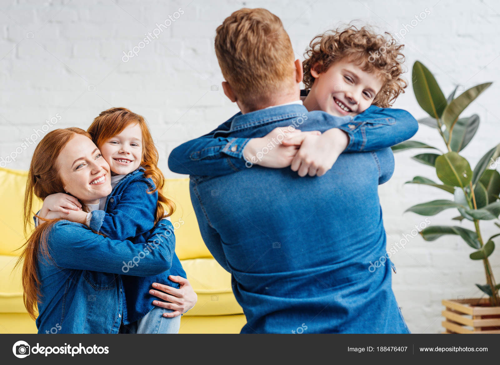 Cute family parents and children embracing at home stock image