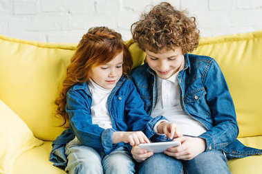 Kids having fun using smartphone