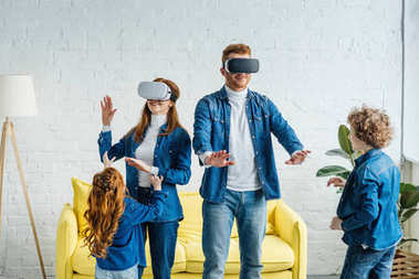 Kids playing with parents wearing vr glasses