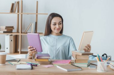 mixed race female student choosing books