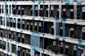 Photo shelves with equipment for bitcoin mining farm