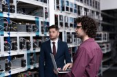 Photo successful businessman and computer engineer working together at bitcoin mining farm