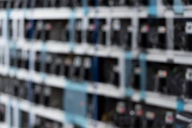 blurred shot of cryptocurrency mining farm