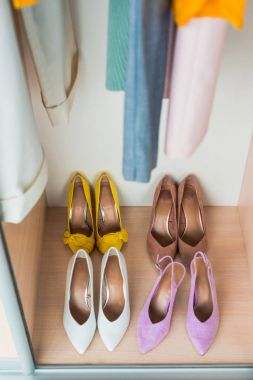 high angle view of colorful high heels in cabinet