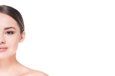 cropped shot of half of face of young woman isolated on white