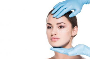 doctor touching face of woman with dotted line for plastic surgery isolated on white