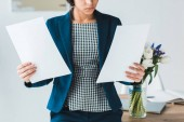 Close-up view of business documents in female hands