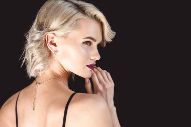 blonde elegant girl, isolated on black