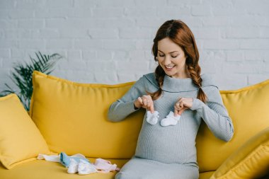 pregnant with newborn shoes
