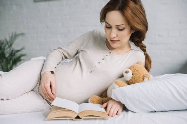 pregnant on bed