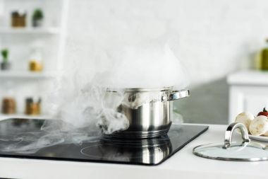 steam over pan on electric stove in kitchen