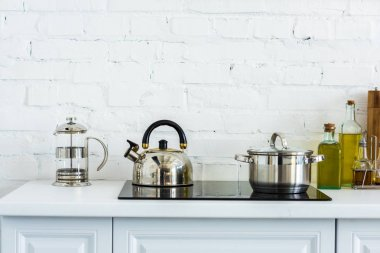 kettle and pan on electric stove in kitchen