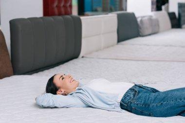 Customer lying on orthopedic mattress