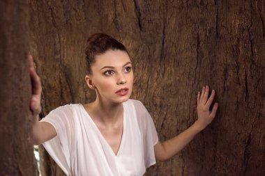 beautiful girl in white dress posing for fashion shoot