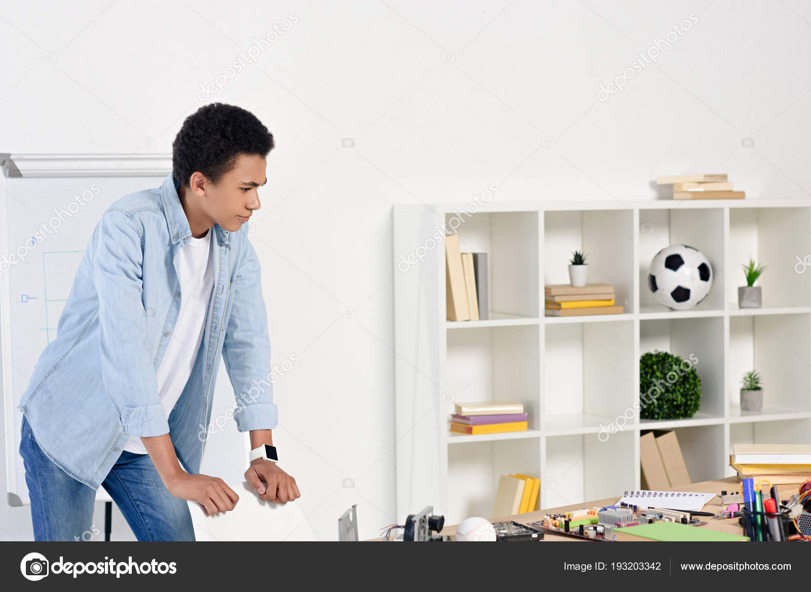 African American Teenager Leaning Chair Looking Table Technical Equipment Home u2014 Stock Photo  sc 1 st  Depositphotos & African American Teenager Leaning Chair Looking Table Technical ...