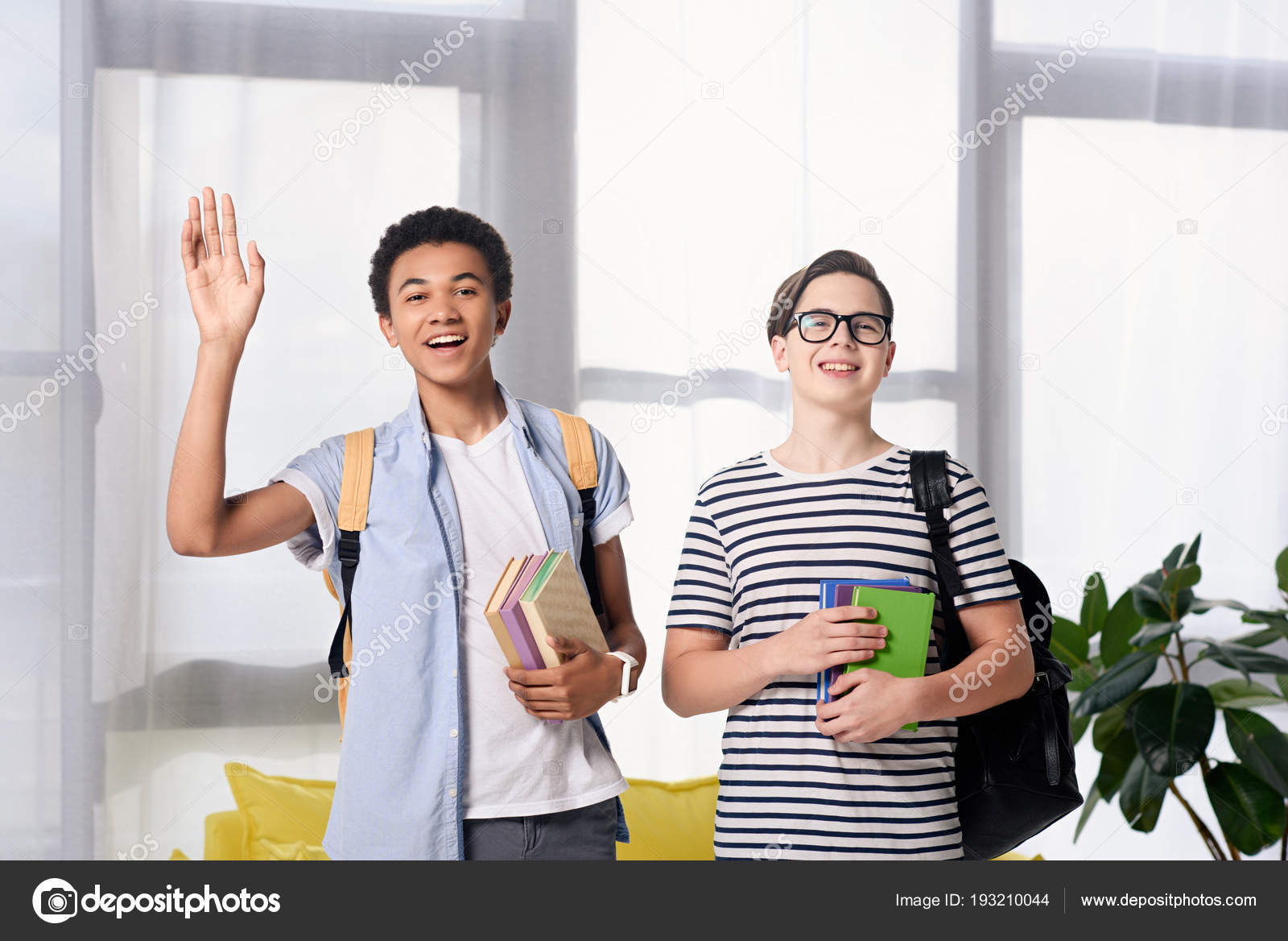 Multicultural teen boys greeting someone home stock photo multicultural teen boys greeting someone home stock photo m4hsunfo