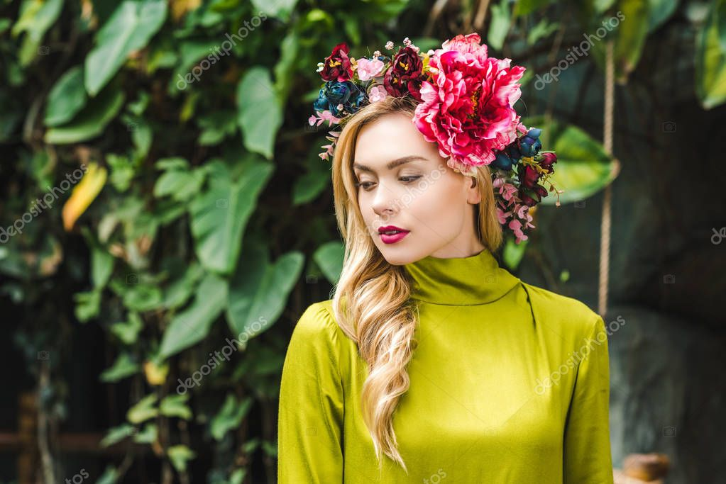 Attractive young woman with floral wreath with green rainforest on background stock vector