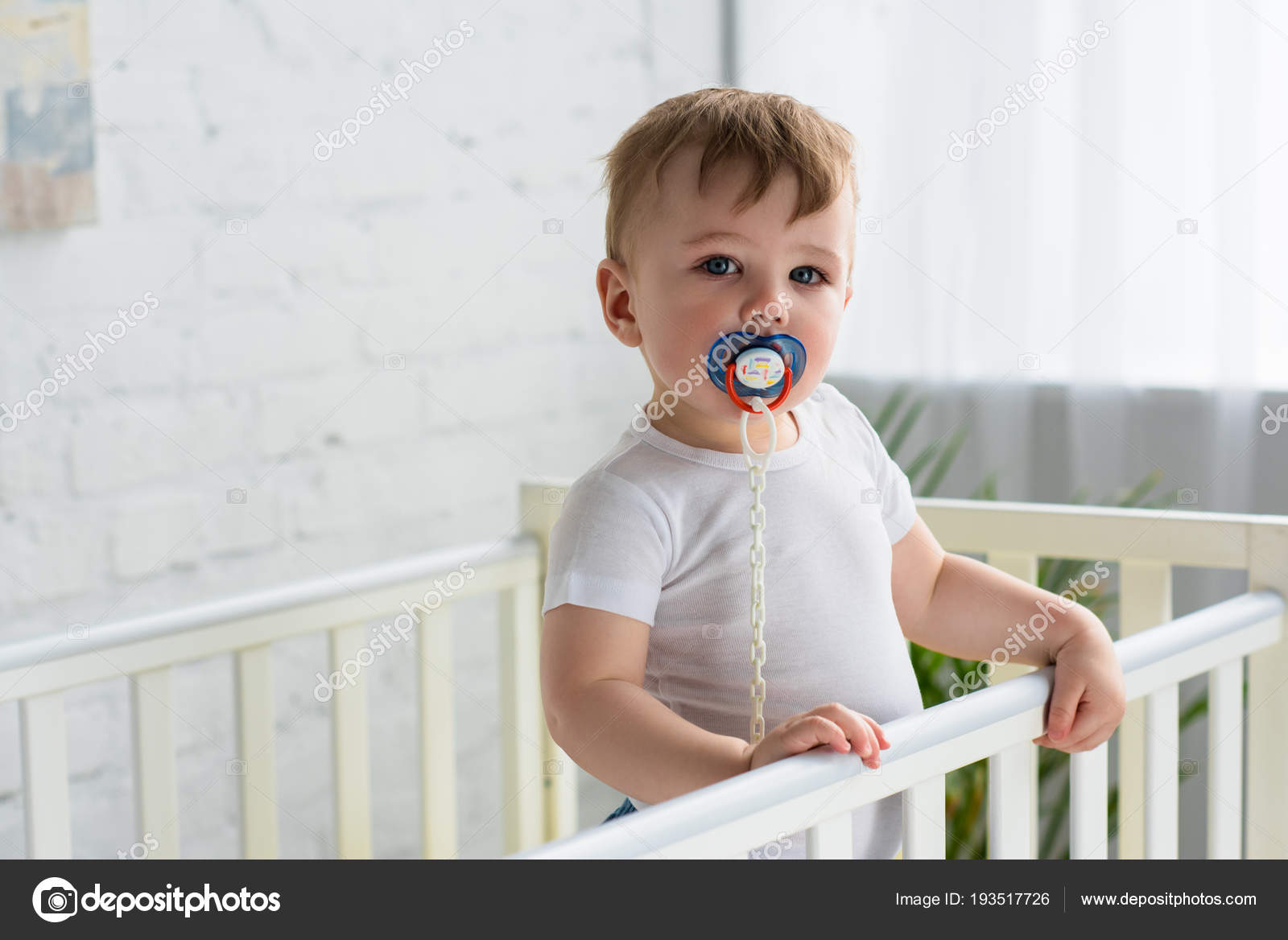 Cute Little Baby Boy Pacifier Baby Crib Looking Camera Home Stock