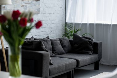 selective focus of empty living room with grey sofa
