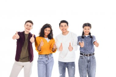 portrait of multiracial teen friends showing thumbs up isolated on white