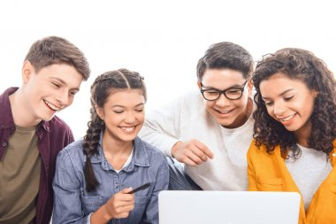 portrait of smiling multiethnic teen friends using laptop together isolated on white