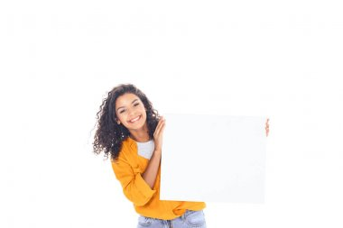 smiling african american teenager with blank banner in hands isolated on white