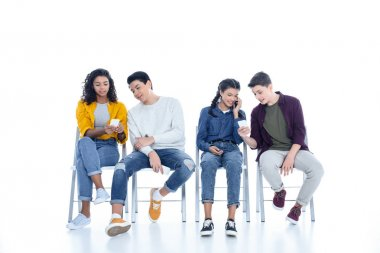 Group of teen students using smartphones on chairs isolated on white stock vector