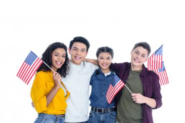 smiling teen students with usa flags  isolated on white