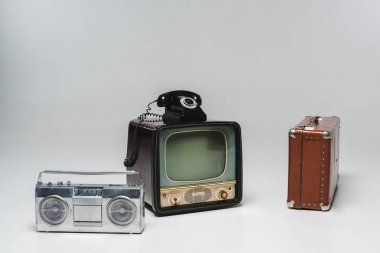composition of various vintage objects on grey