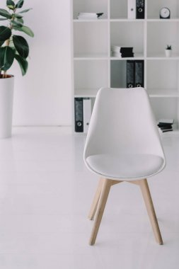 white chair in modern light workplace