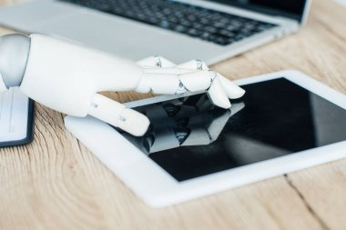 close-up view of robot using digital tablet with blank screen