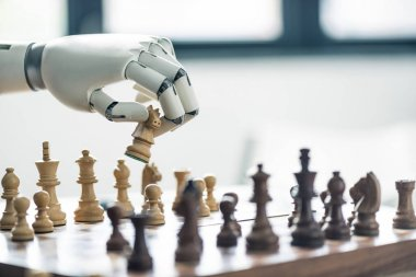 close-up view of robot playing chess, selective focus